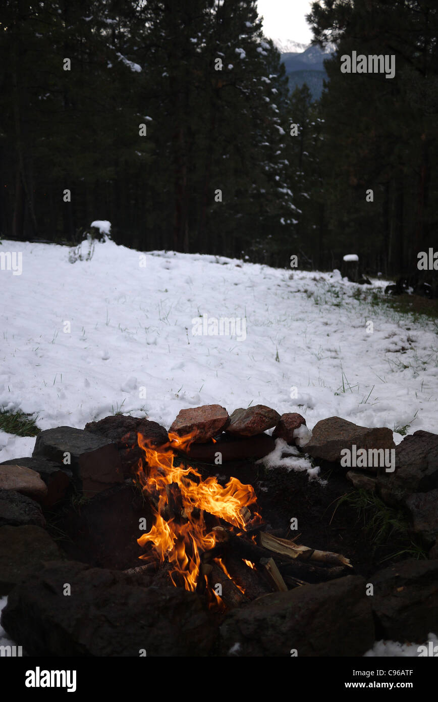 fire pit in snow - Stock Image