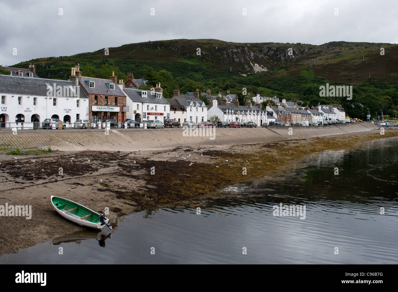 The town of Ullapool is on the shore of Lochbroom and is the port for ferries to Stornoway in the Western Isles. - Stock Image