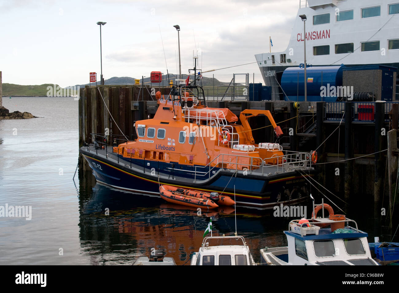 The RNLB lifeboat Edna Windsor is moored in Castlebay on the island of Barra, Scotland ready for duty. - Stock Image