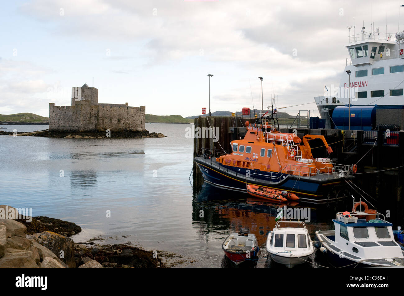 The RNLB lifeboat Edna Windsor is moored in Castlebay on the island of Barra ready for duty. - Stock Image