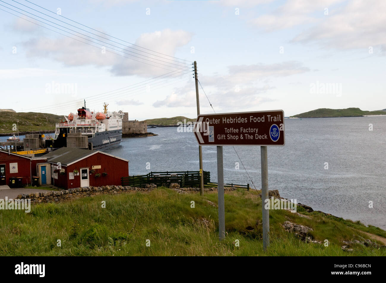 A sign in Castlebay on the island of Barra for the Outer Hebrides Food trail . The ferry MV Clansman is in the background - Stock Image