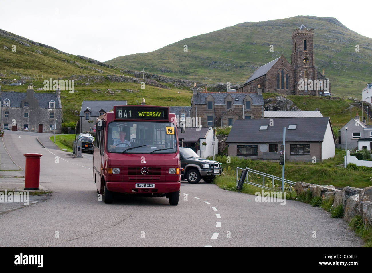 A minibus operated by R Macmillan passed through Castlebay on  the island of Barra heading to Vatersay. - Stock Image