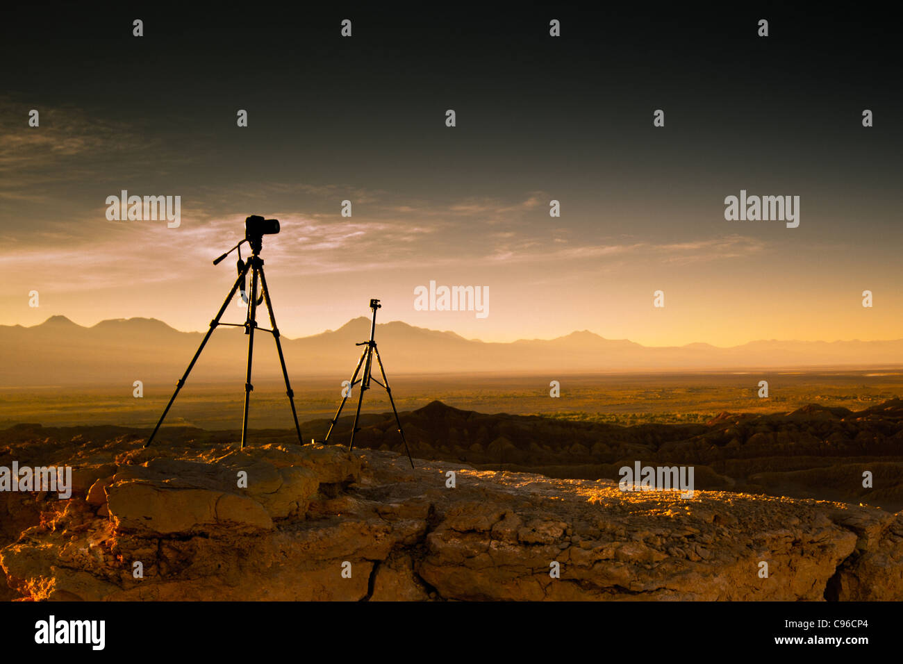 a couple of tripods waiting for taking the shot at the moon valley in san pedro de atacama chile - Stock Image