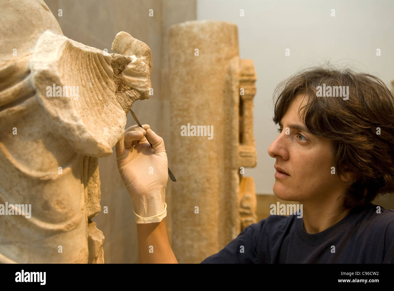 Archaeologist carrying out restoration work on an artefact at Beirut's National Museum, Beirut, Lebanon. - Stock Image
