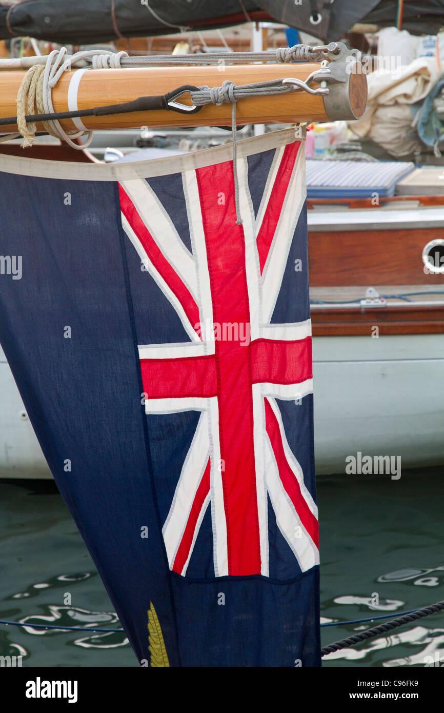 English flag on Classic yacht sailing boats - Stock Image