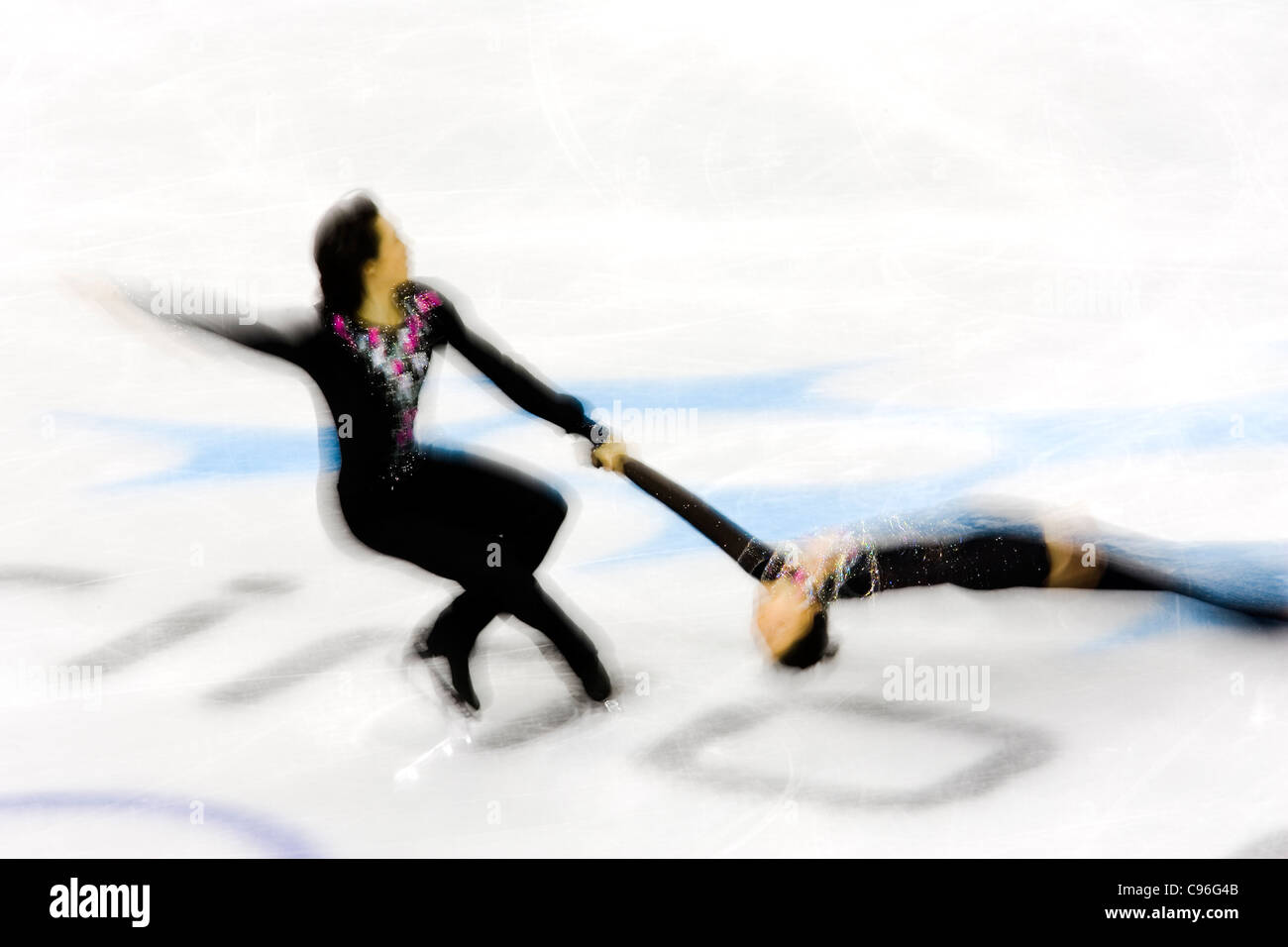 Blurred action of pairs figure skaters. - Stock Image