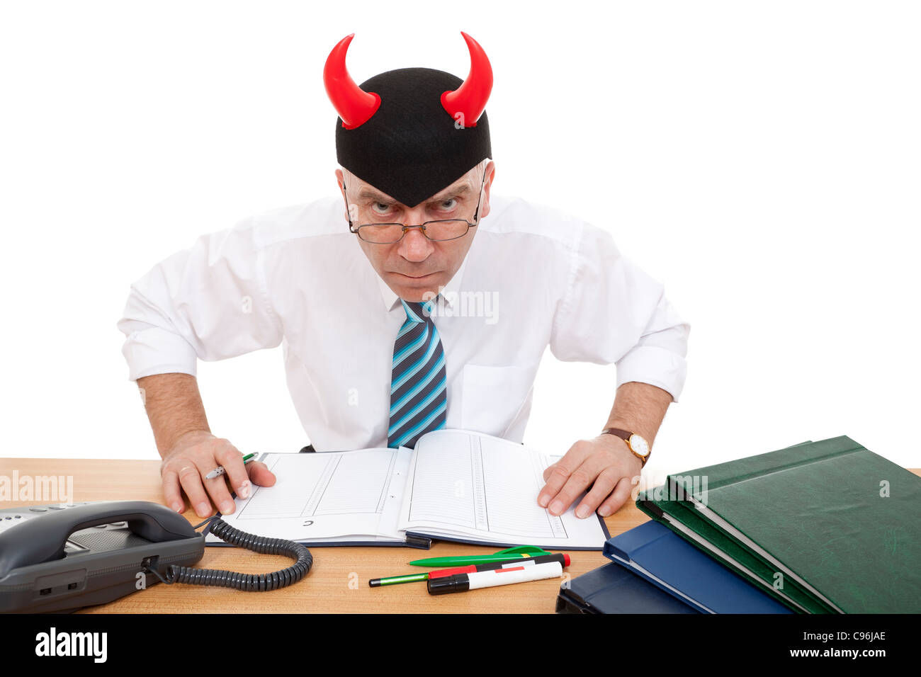 furious official near desk in office on white background - Stock Image