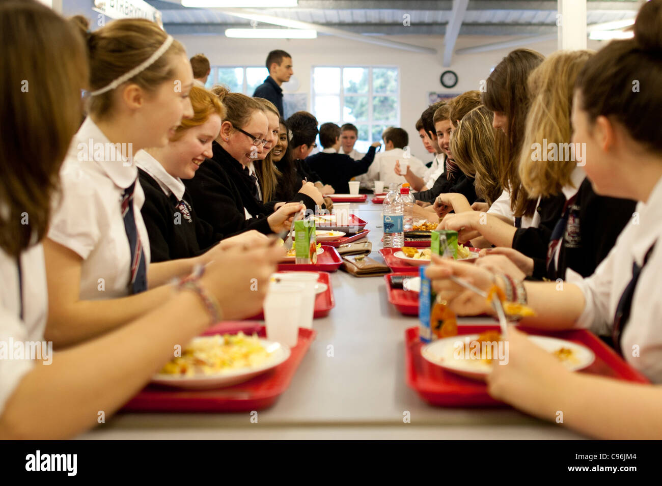 Secondary school children in the canteen having lunch, Wales UK - Stock Image