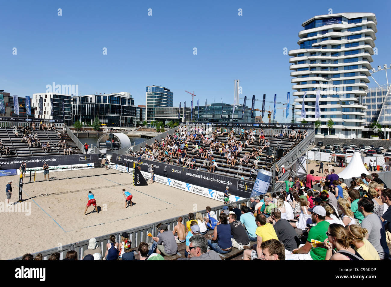 Beach Volleyball Contest in Front of Marco-Polo-Tower and the Unilever headquarters on the Strandkai quay, Hamburg - Stock Image