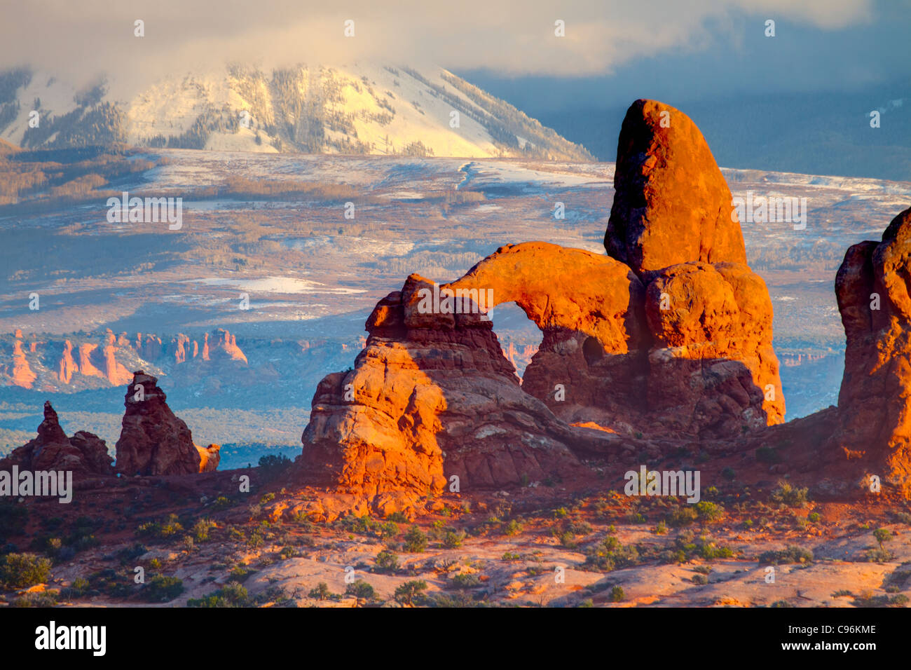 Turret Arch and La Sal Mountains, Arches National Park, Utah Windows Section Sunset - Stock Image