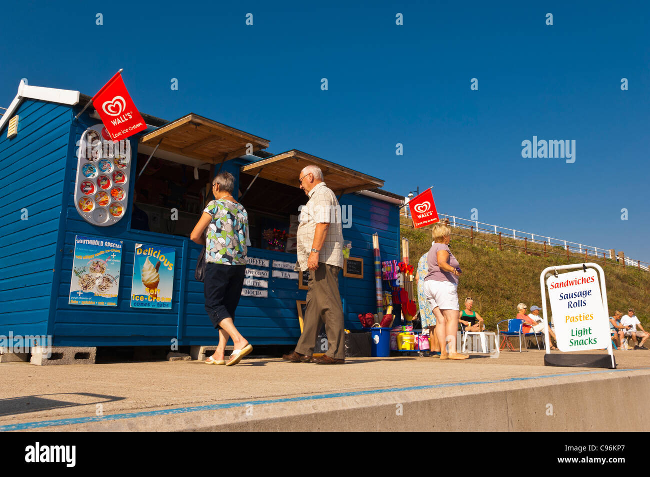People on the seafront buy ice creams in Southwold , Suffolk , England , Britain , Uk - Stock Image