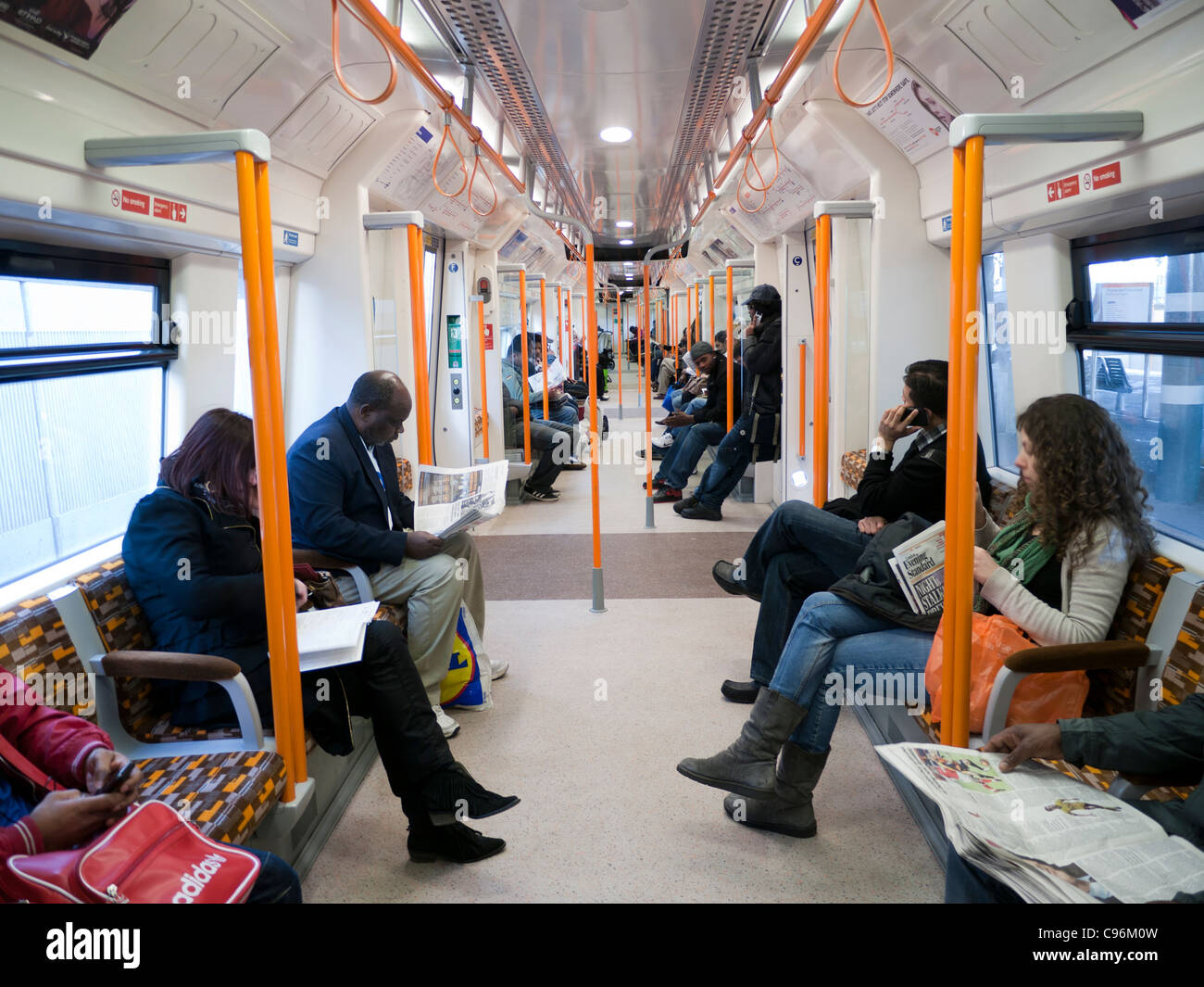London Overground walk-through train carriage in Britain - Stock Image