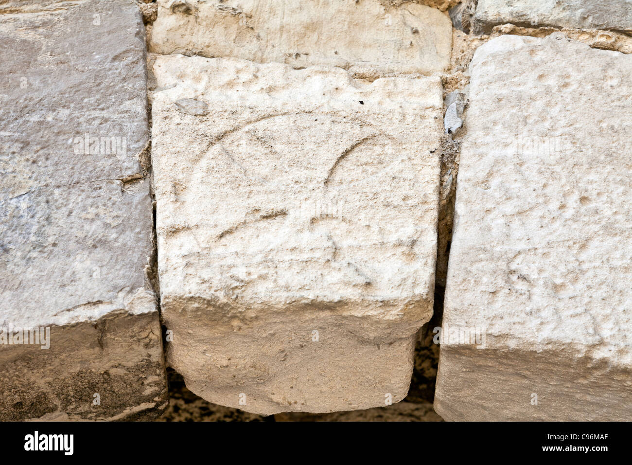 The Templar Knights Cross carved in the entrance of the Leiria Castle. Leiria, Portugal. - Stock Image