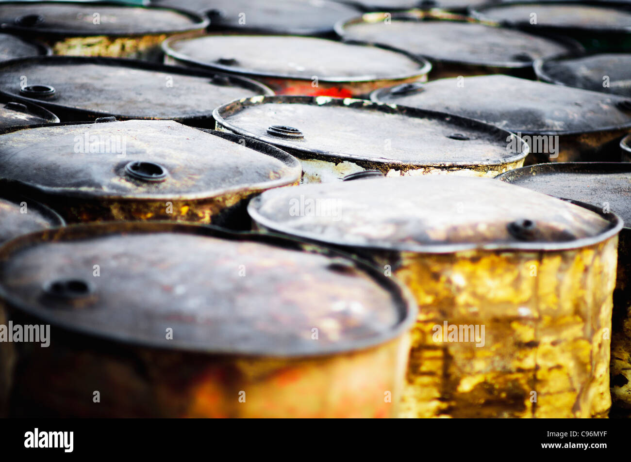rusty oil barrels on beach - Stock Image