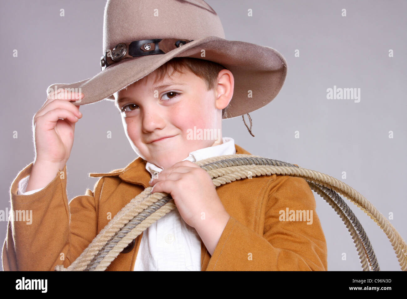 A cute cowboy greeting with a hat nod Stock Photo  40100913 - Alamy 69693f4bfd7d
