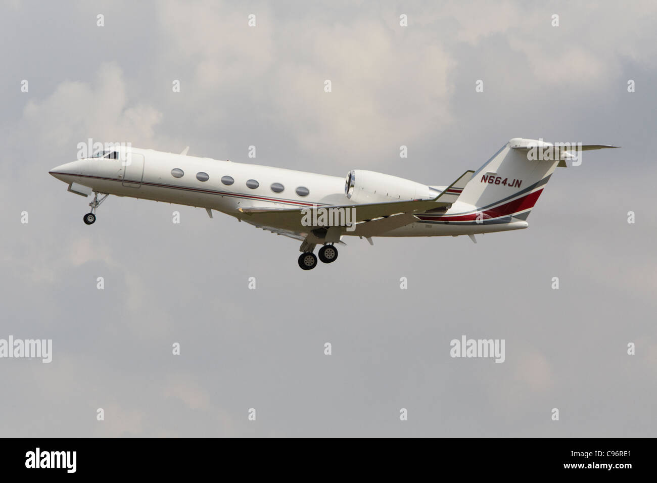 Gulfstream G-IV climbing after taking off from runway - Stock Image
