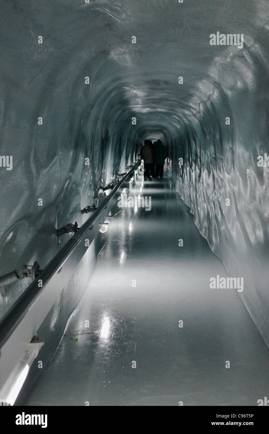 Access to the ice palace is through a long, slippery tunnel which cuts its way through the solid ice of the Aletsch - Stock Image