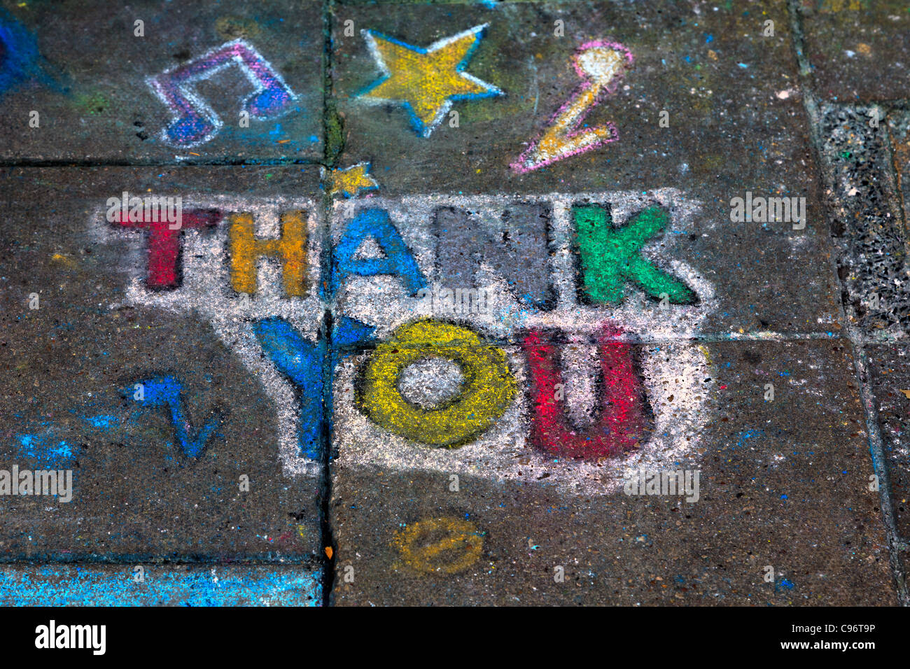 Thank you drawn in chalk on a public pavement - Stock Image