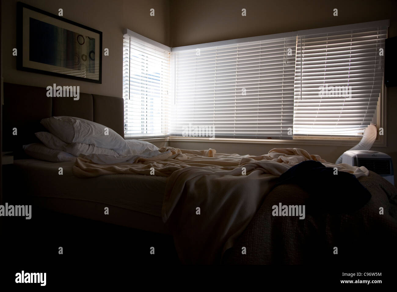 Unmade bed in Hotel room - Stock Image