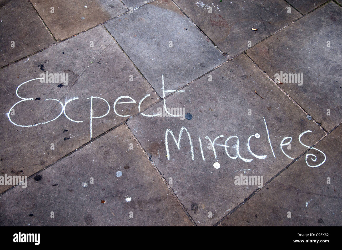 November 12th 2011Occupy London camp at St Paul's.  Writing on paving stones says Expect Miracles - Stock Image