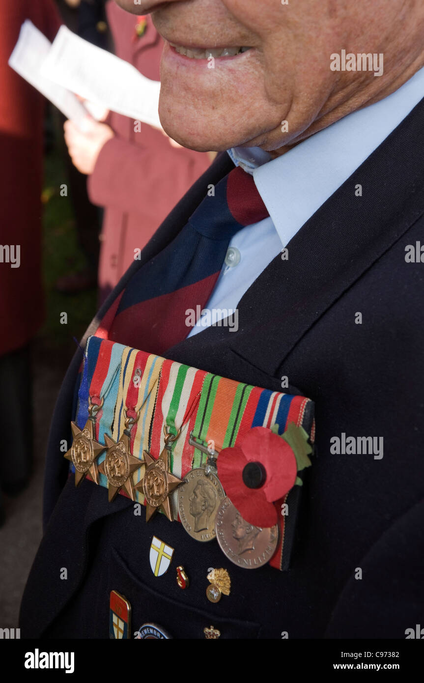 An old soldier, a WWII veteran wears his campaign war medals with pride on Remembrance Day. - Stock Image
