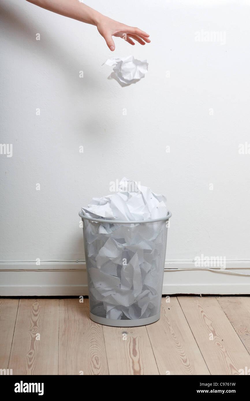 Paper in the bin - Stock Image