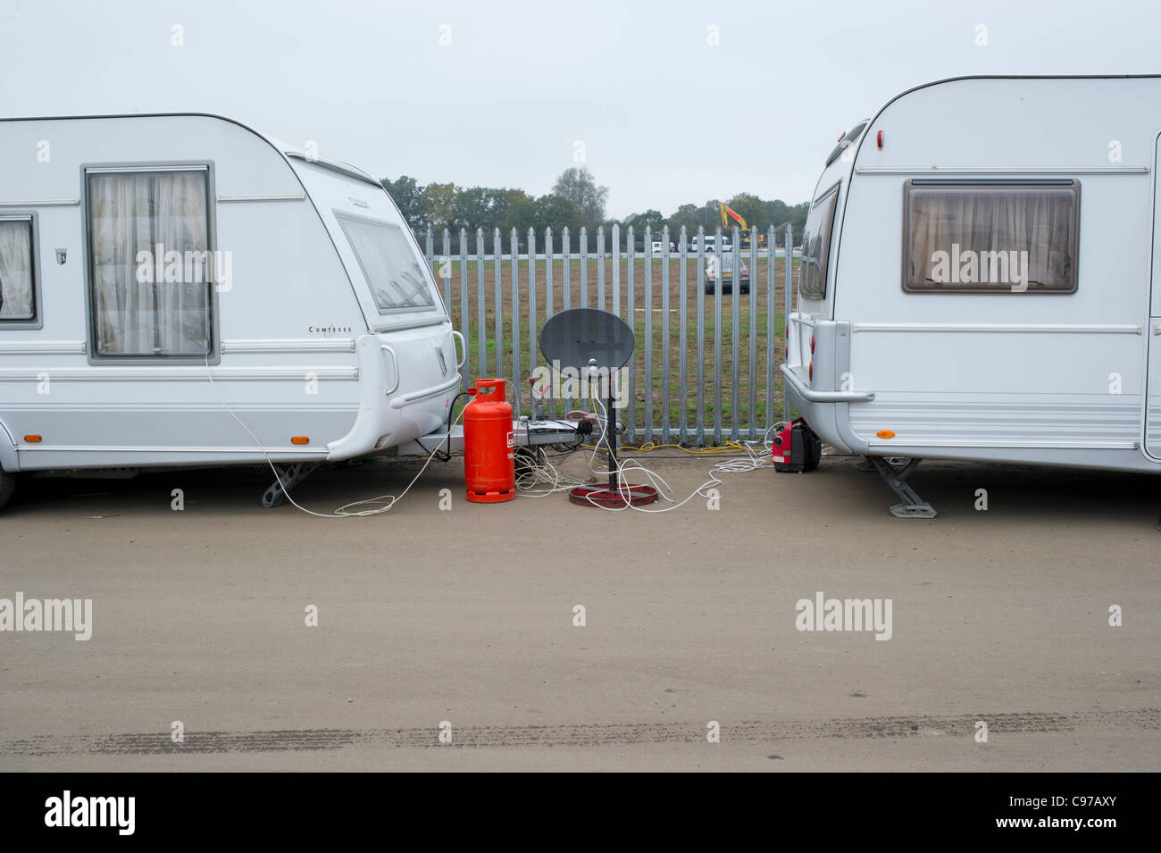 16th November 2011. Dale Farm Essex, UK. Two caravans with a  satellite dish parked on the legal side of the Dale - Stock Image