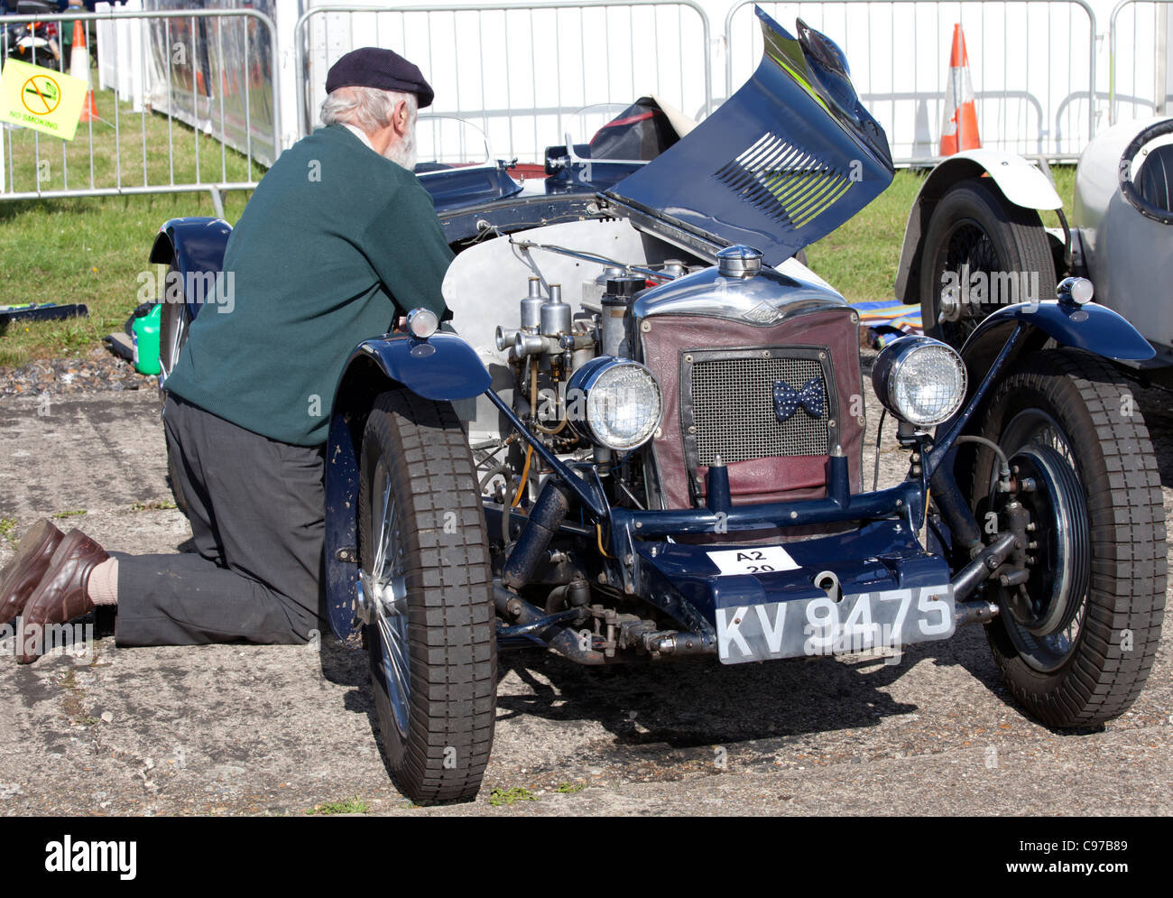 Man working on a 1934 Riley Ulster Imp - Stock Image