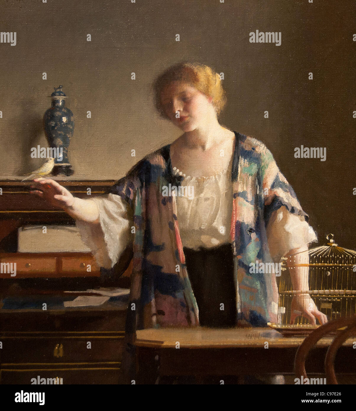 The Canary 1913 by William MCGregor Paxton American - Stock Image