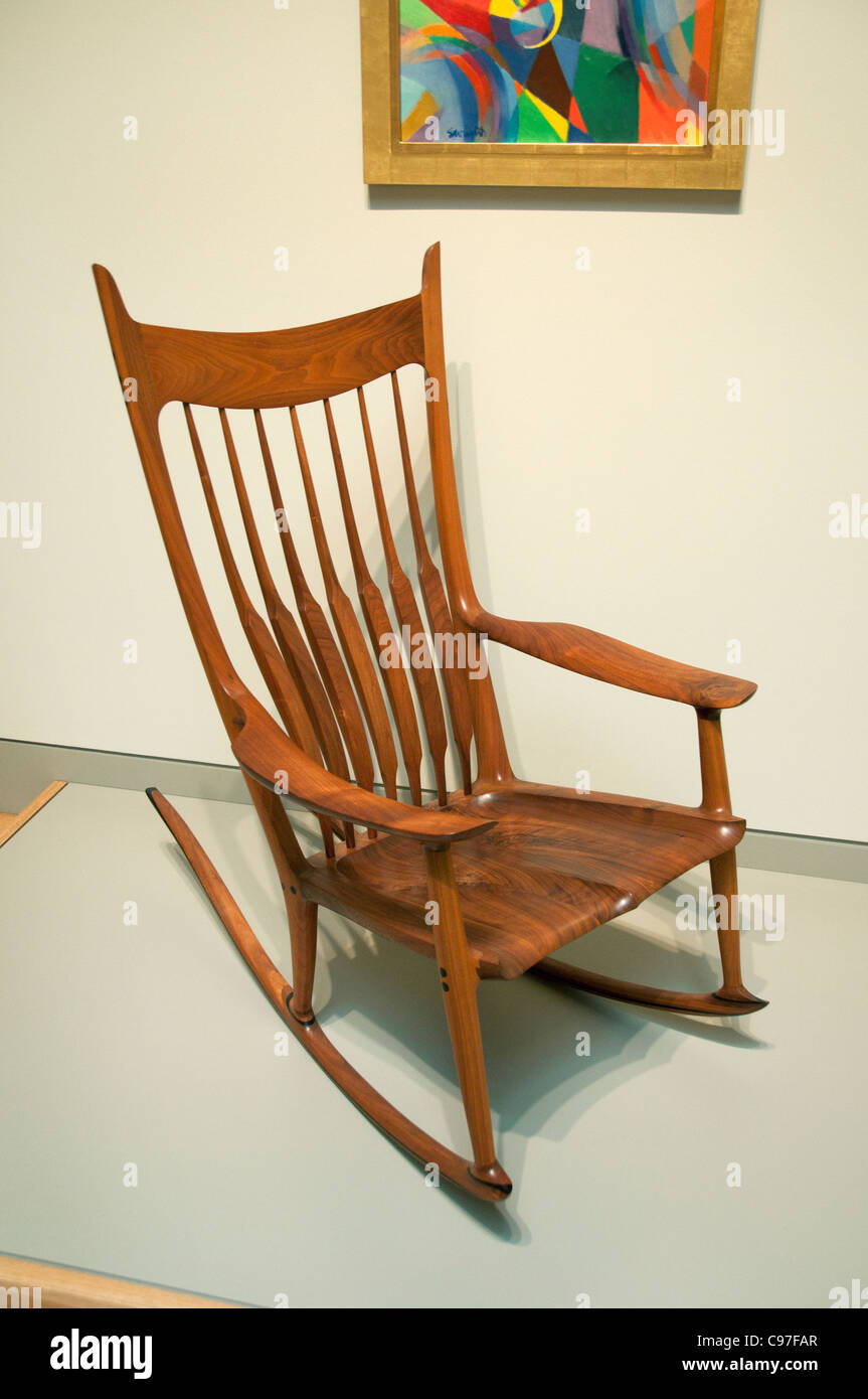 Rocking chair by Sam Maloof furniture designer and woodworker American - Stock Image