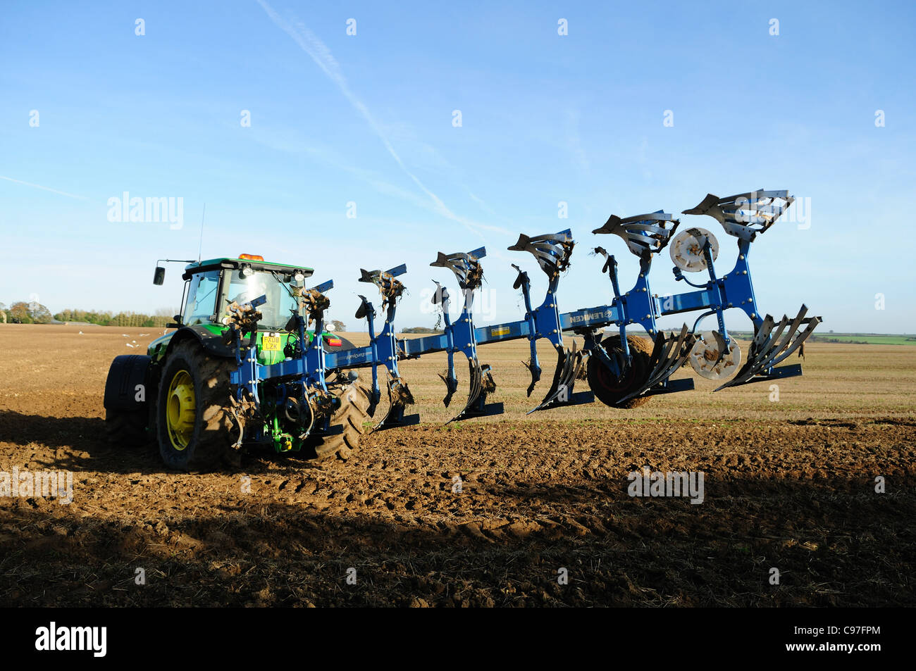 Tractor and Plowing ,Lincolnshire Wolds England. - Stock Image