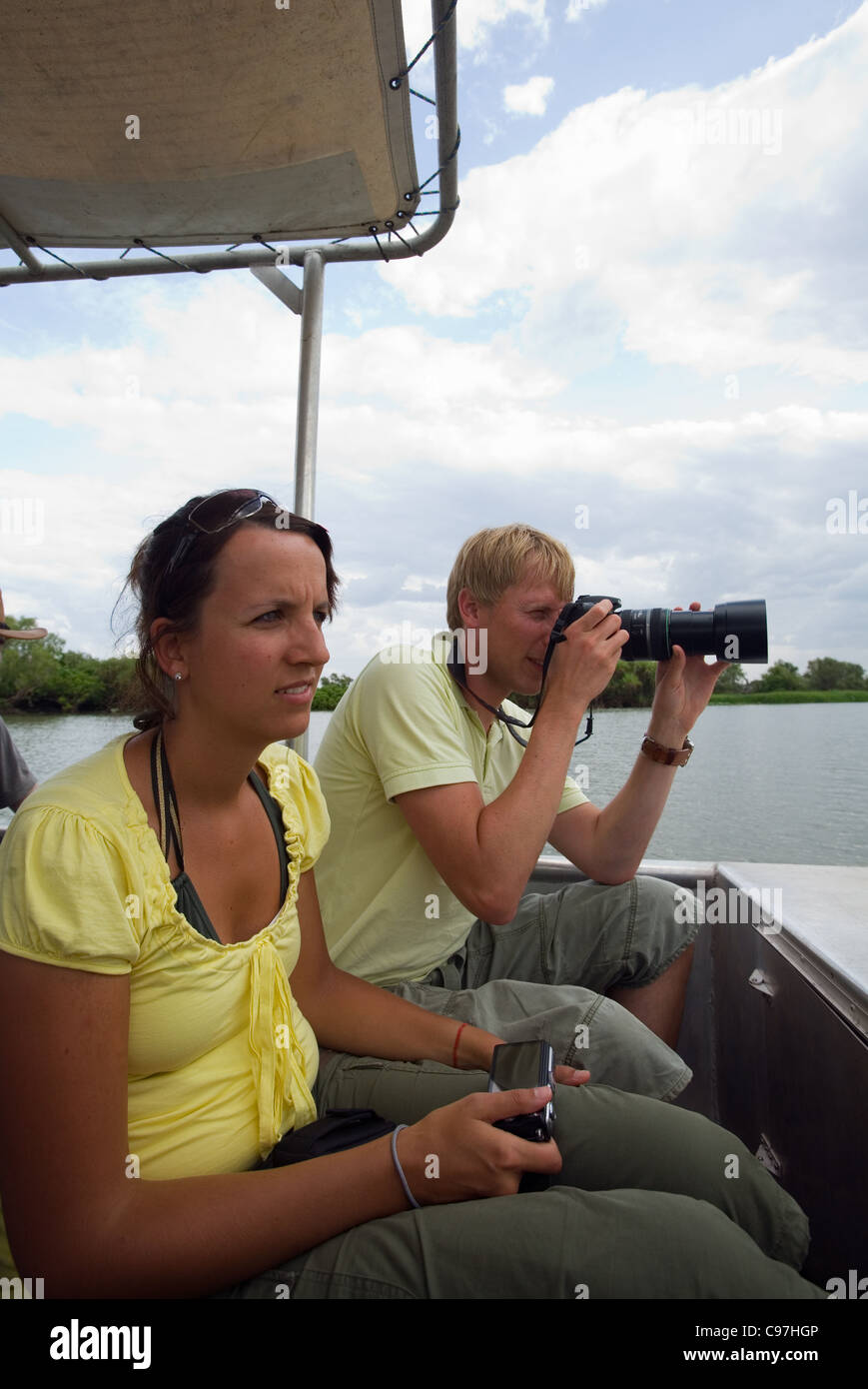 Tourists on a wildlife cruise in the Mary River Wetlands.  Mary River National Park, Northern Territory, Australia - Stock Image