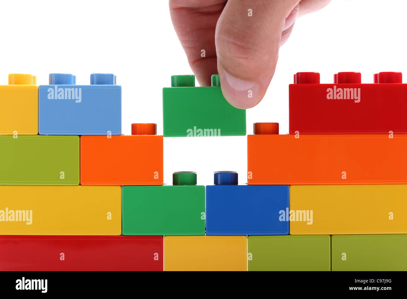 Building a wall from blocks - Stock Image