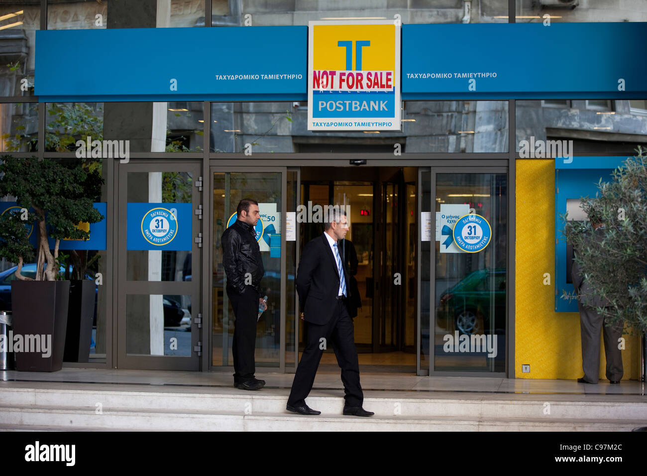 TT Hellenic Postbank with sign Not For Sale during economic downturn in Athens, Greece. - Stock Image