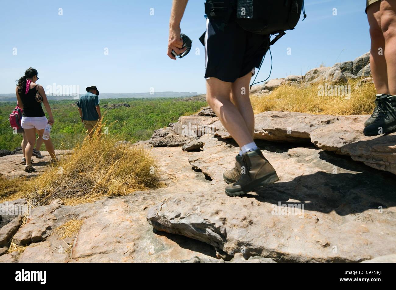Tourists hiking across the Nadab escarpment at Ubirr.  Kakadu National Park, Northern Territory, Australia - Stock Image