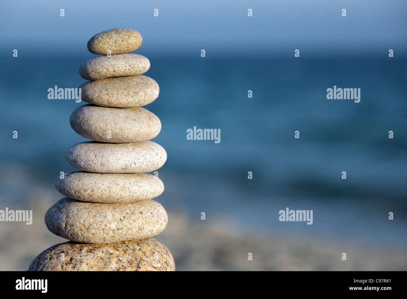 Stone balance pebble stones on beach - Stock Image