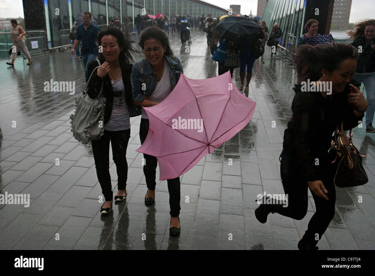 shoppers in a storm at westfield stratford london Stock Photo