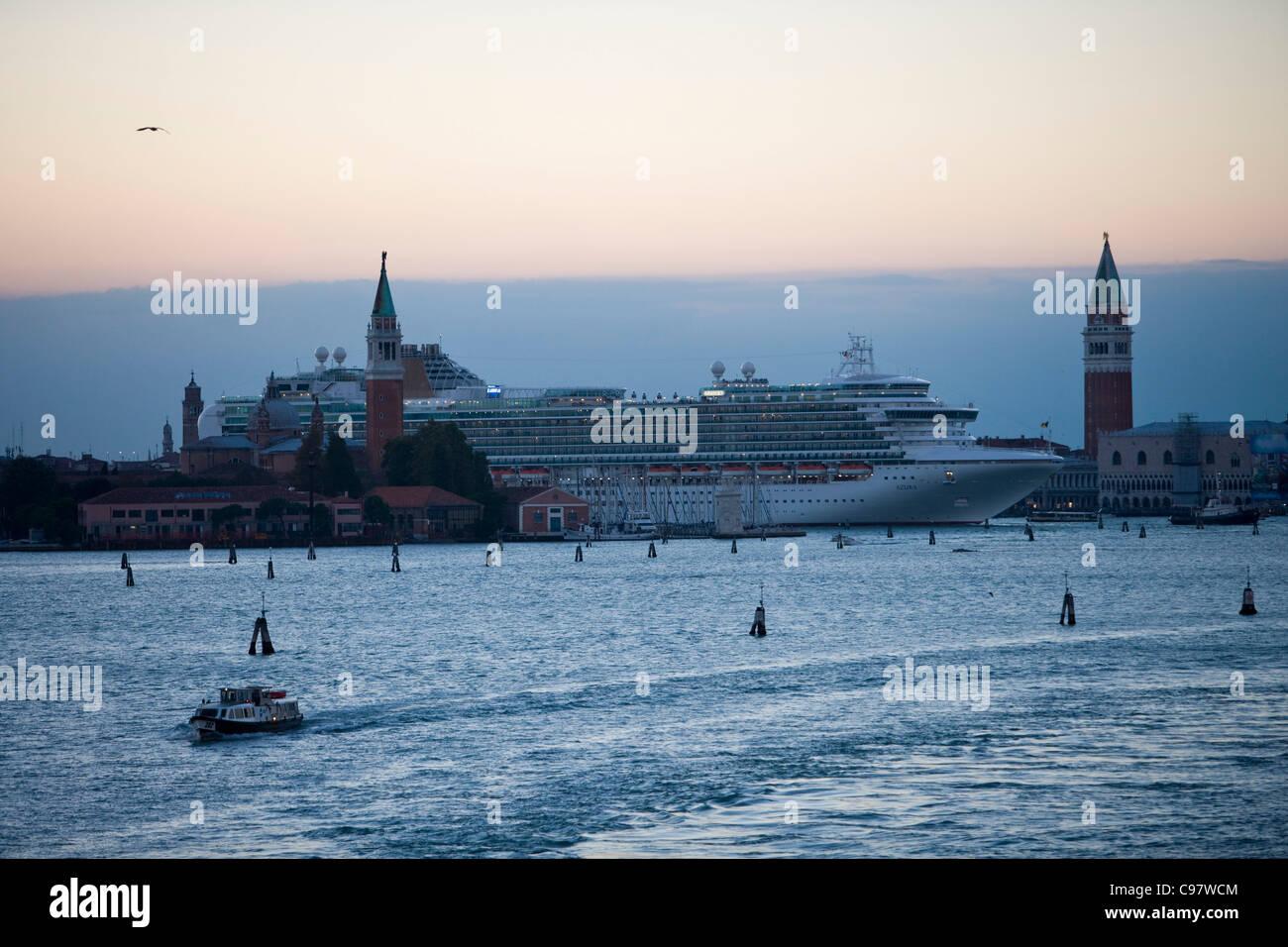 Cruiseship Azura, P and O Cruises, on Canale di San Marco and Campanile tower at dusk, Venice, Veneto, Italy, Europe - Stock Image