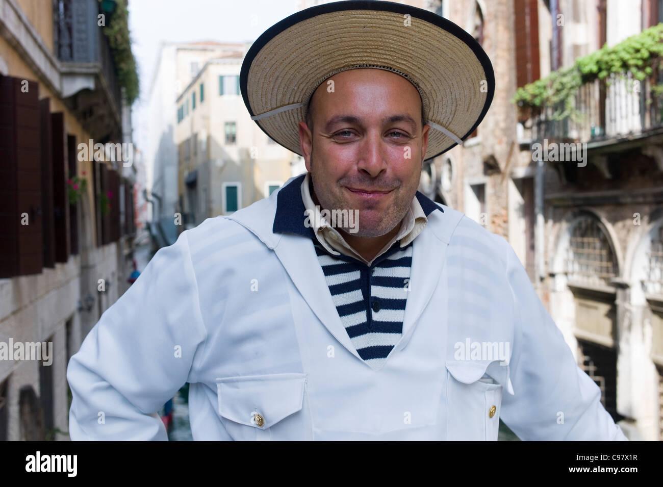 Cheerful gondolier, Gondolieri wearing traditional clothes, Venice, Veneto, Italy, Europe - Stock Image
