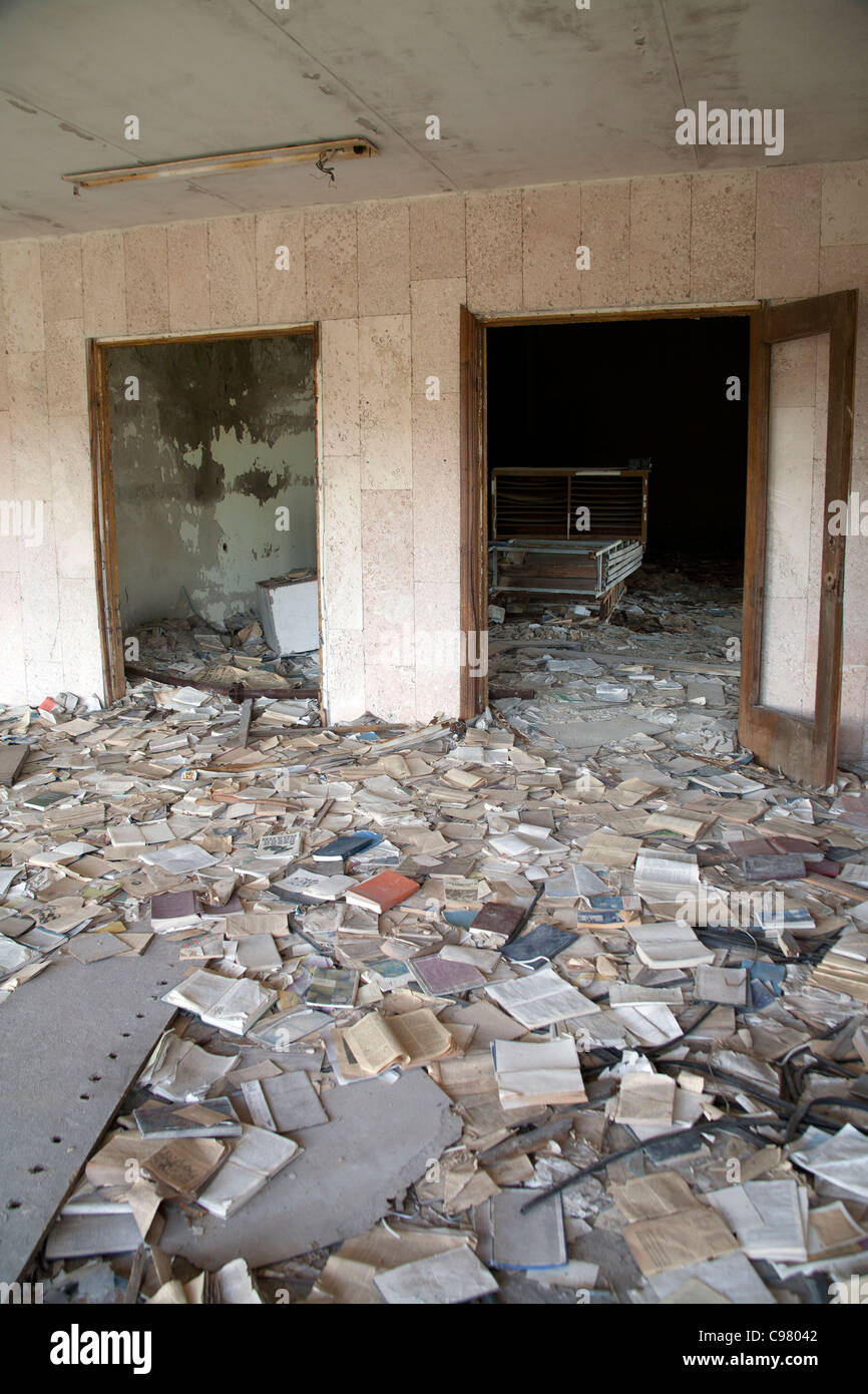Piles of books scattered over the floor of the Palace of Culture Lenin Square, Pripyat Chernobyl exclusion zone - Stock Image