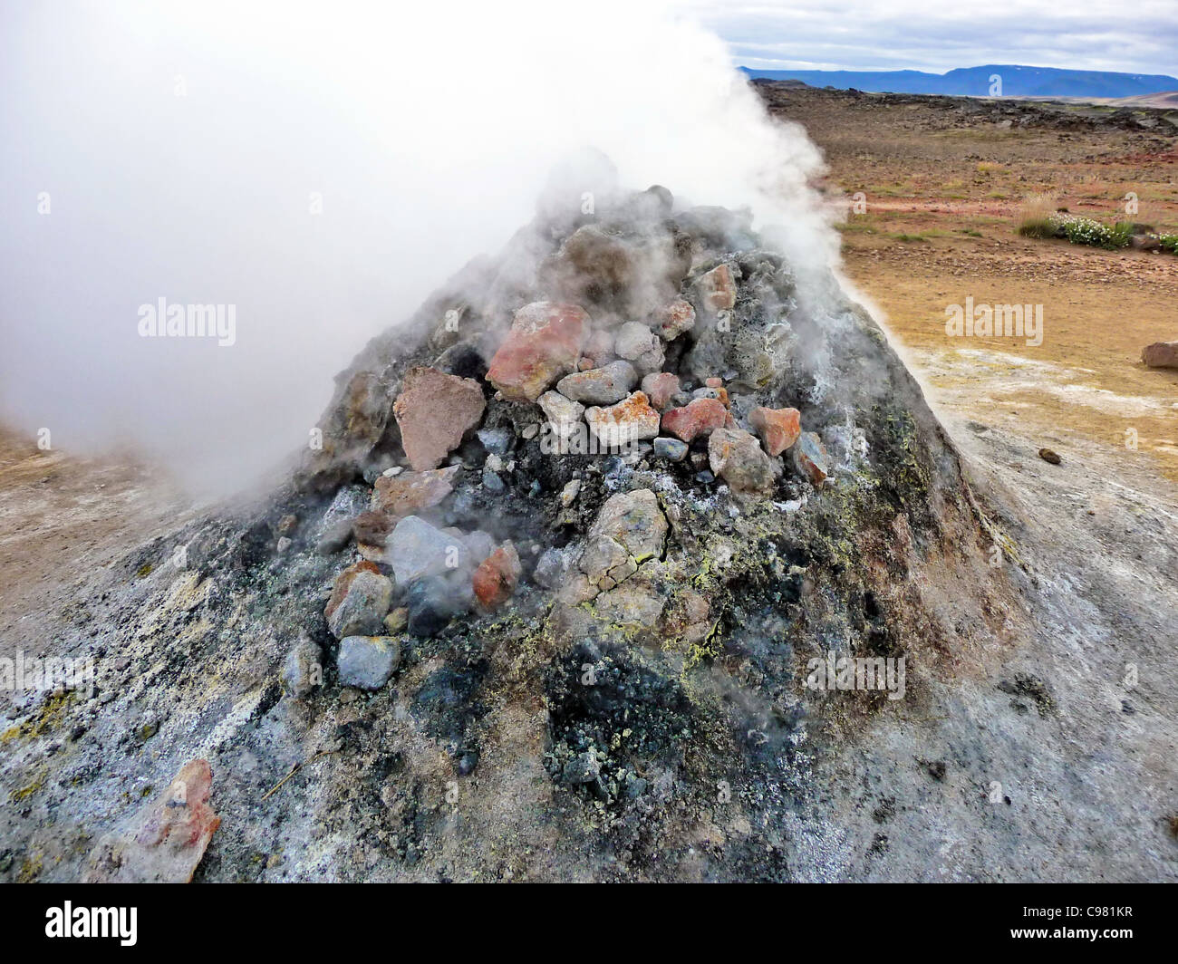 Rock pile geothermal fumarole in iceland in summer time - Stock Image