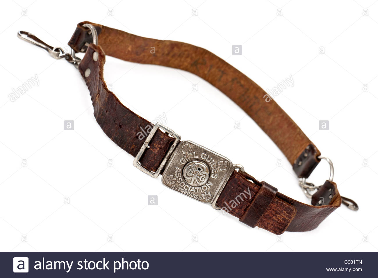 "Vintage Girl Guides Association leather belt with buckle showing their motto ""Be Prepared"" Stock Photo"