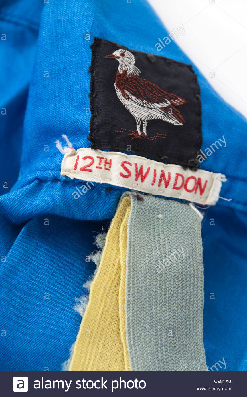 Vintage 1970's Girl Guides Association blue uniform shirt with shoulder badge from 12th Swindon division, Wiltshire, - Stock Image