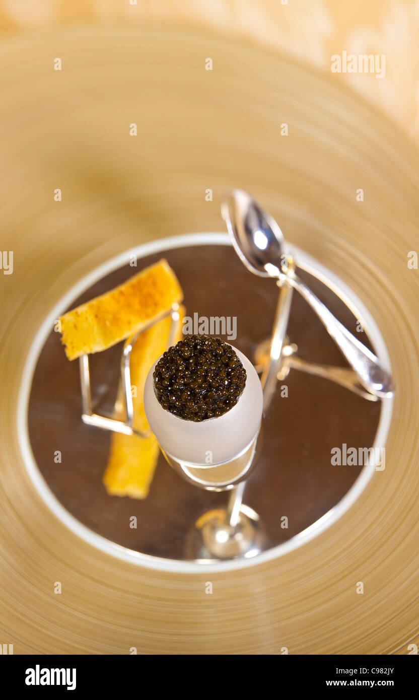 Caviar with egg, garnished with a crusty finger of bread., CHATEAU SAINT-MARTIN & SPA - 2490 Avenue des Templiers - Stock Image