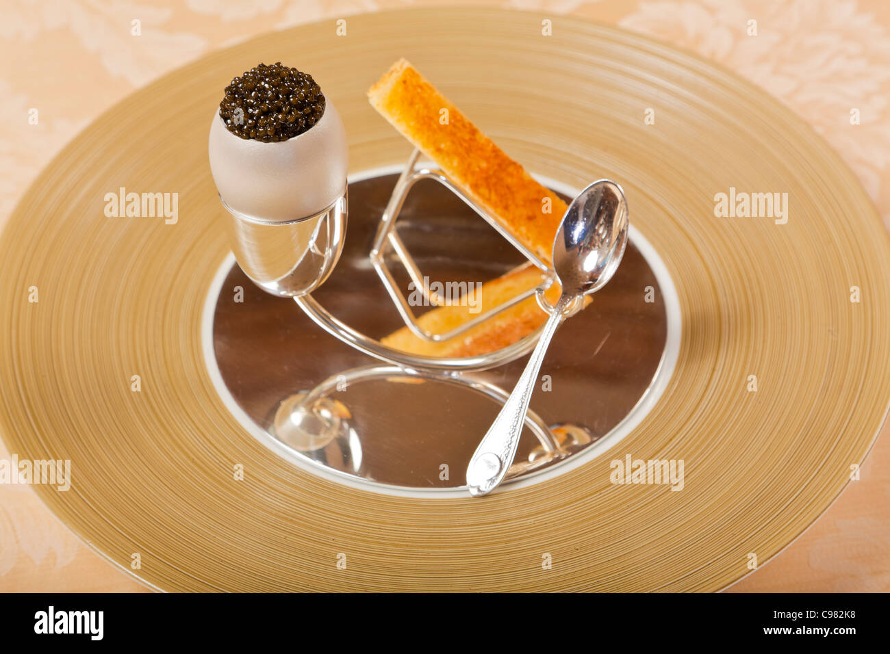 Caviar with egg, garnished with a crusty finger of bread. - Stock Image