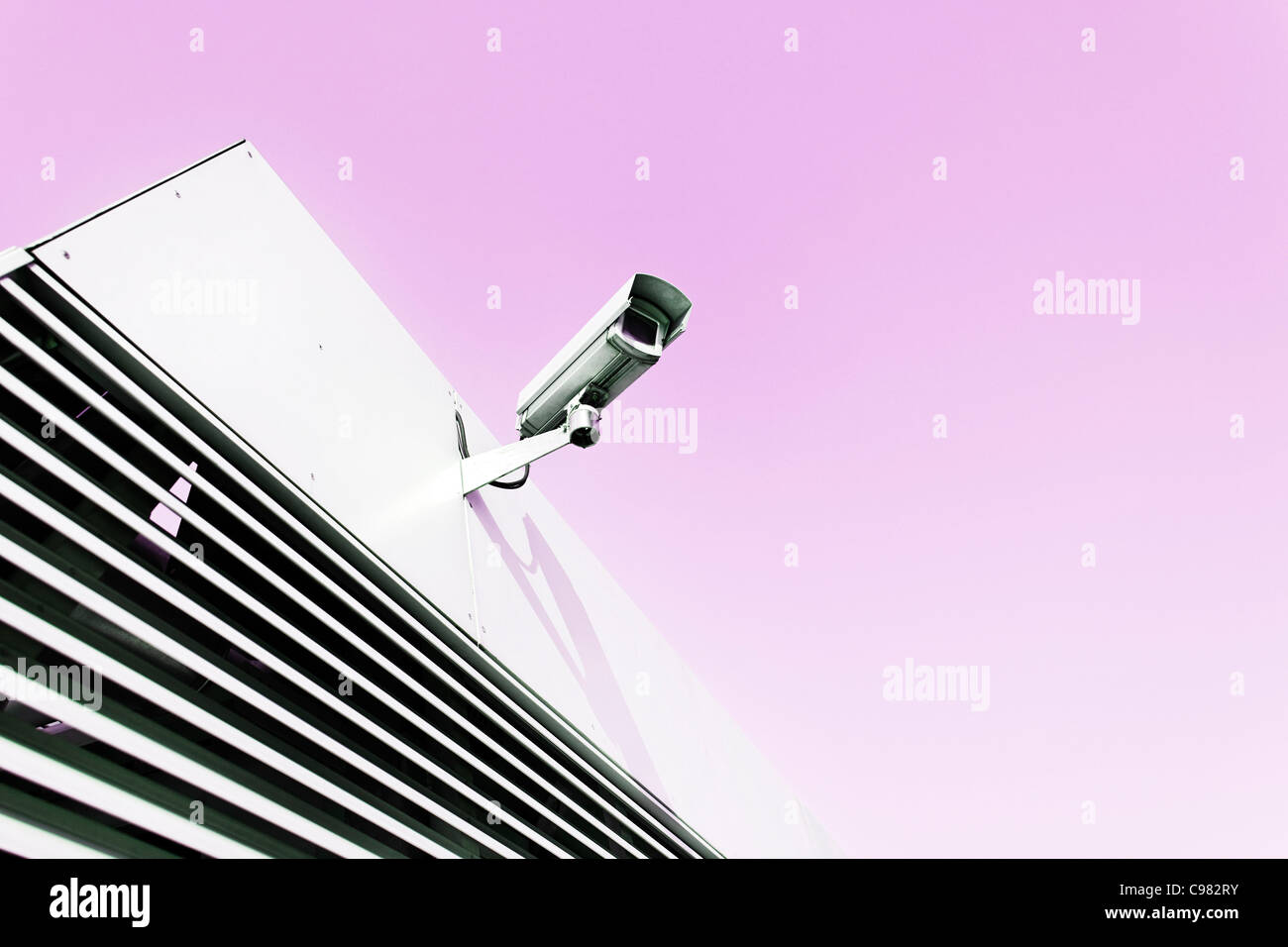 Surveillance camera on a building, cctv, vanilla sky - Stock Image