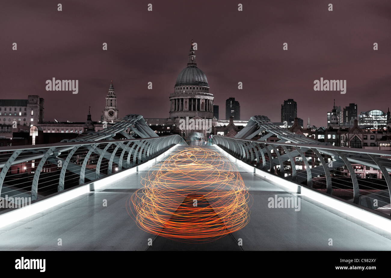 Light Art view of Millennium Bridge crossing the River Thames and St. Paul's Cathedral at night, London, England, - Stock Image