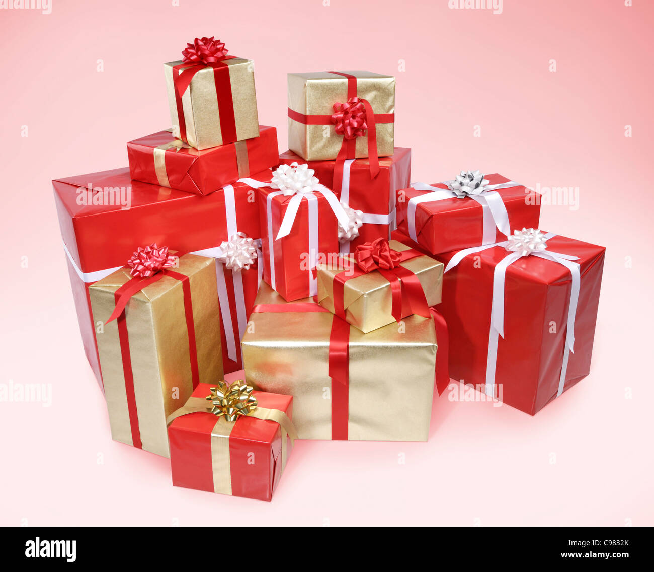 Pile of Christmas gift boxes isolated on pink background with clipping path Stock Photo