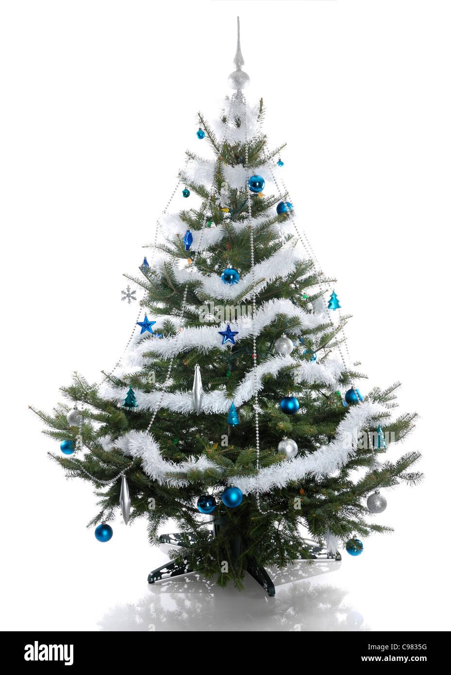 Decorated Christmas tree isolated on white background - Stock Image