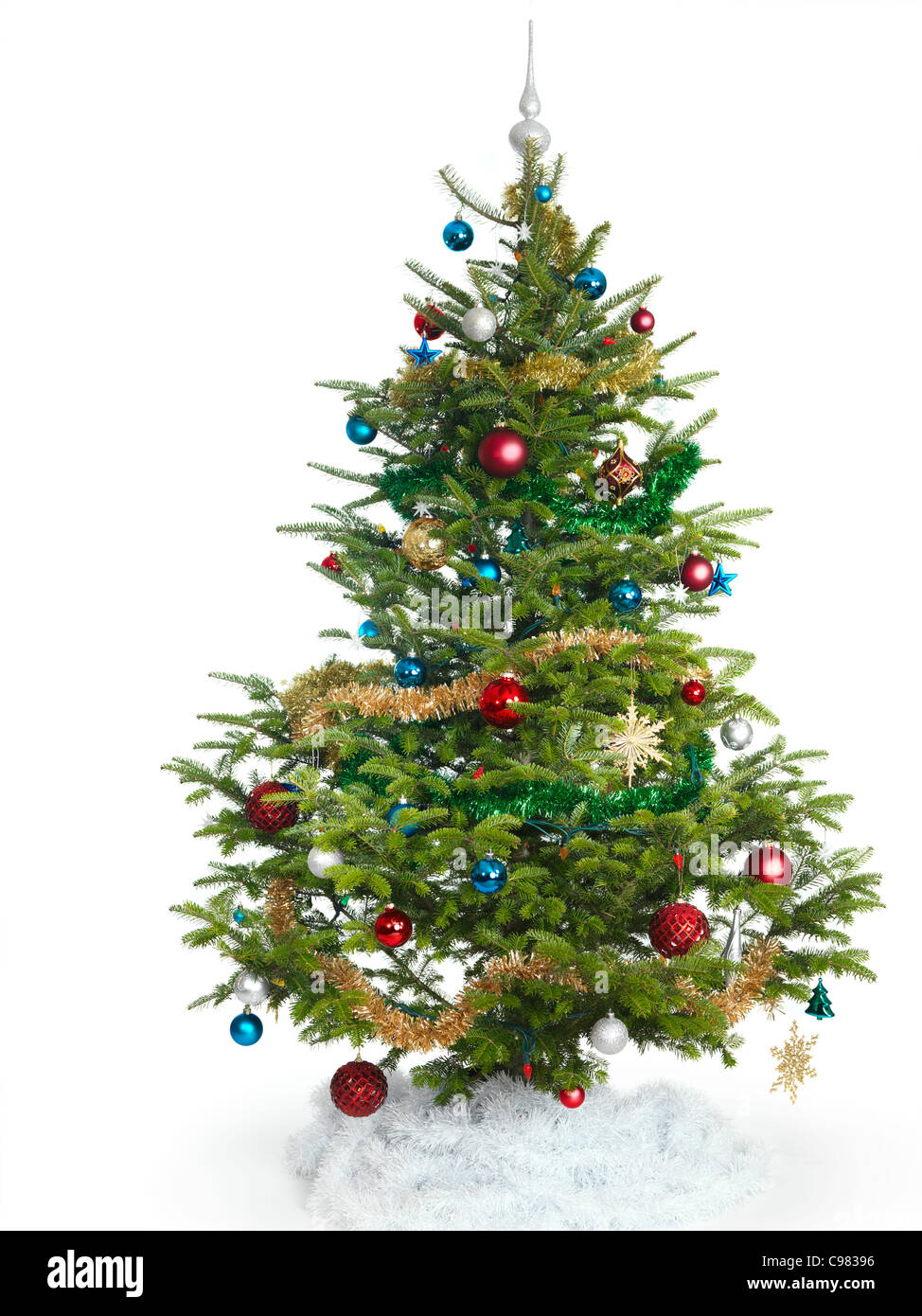 Decorated real Christmas tree isolated on white background - Stock Image
